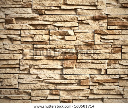 Weathered texture of stained old dark white and gray brick wall background, grungy rusty blocks of brown stone-work technology, colorful horizontal architecture - stock photo