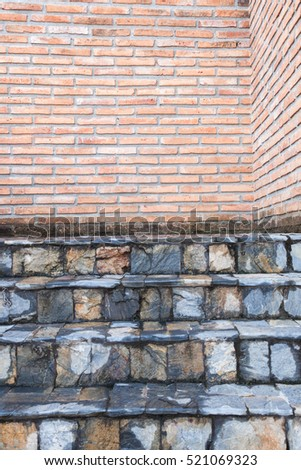 Weathered texture red brick wall background and stone stairs exterior