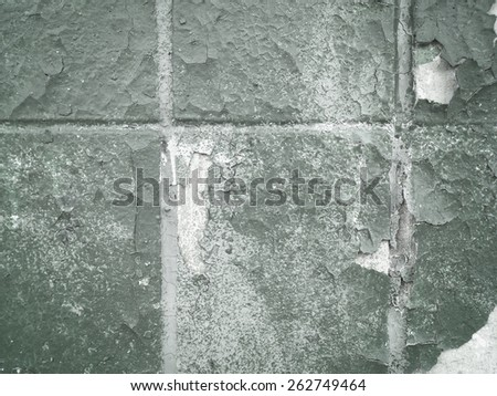 Weathered Tile Covered Painted Wall - stock photo