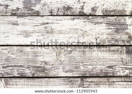 Weathered white painted wooden boards