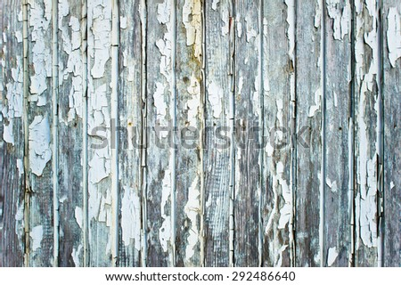 Weathered wood panel with peeling white paint