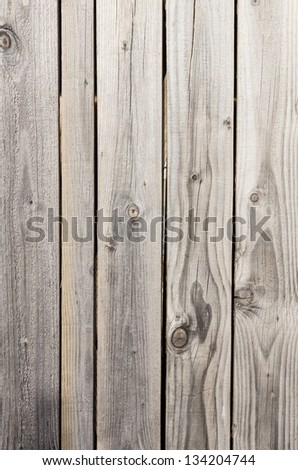 Weathered wooden boards of an old door for background - stock photo