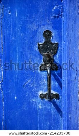 Weathered wooden door with decorative handle.  - stock photo