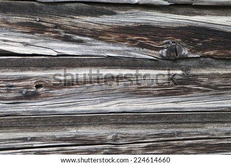 Weathered wooden siding on an old cabin  with wood grain. - stock photo