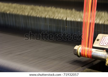 Weave cloth with colorful threads, abstract view.