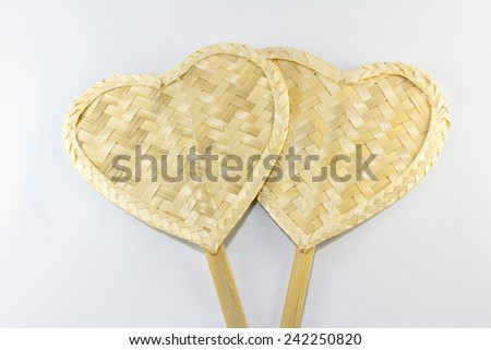 Weave fan heart shape made from bamboo on white background - stock photo