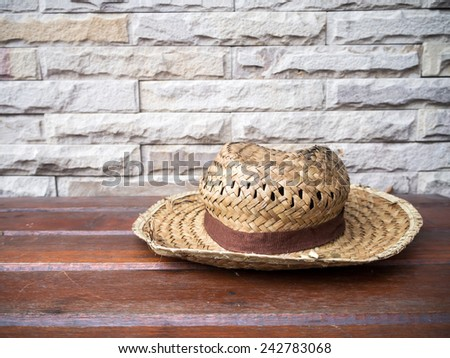 weave hat lay on the bench  - stock photo