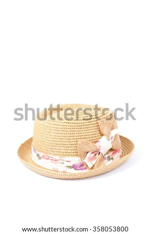 weave hat with bow on white background