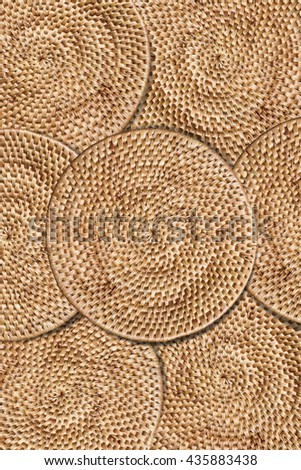 Weave rattan texture background, arranging layers of tradition woven round tray, texture background, vertical composition - stock photo