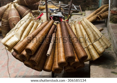 Weaving bamboo fish trap in HungYen, Vietnam. Weaving this tools that used to catch fish is traditional occupation in Hung Yen province.