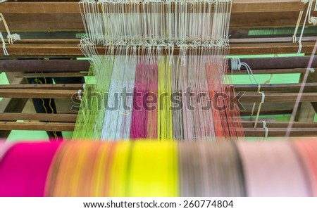 Weaving loom and shuttle on the warp - stock photo