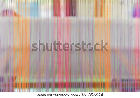 Weaving loom and shuttle on the warp. - stock photo