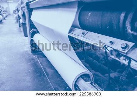 weaving machine produce white cloth - stock photo