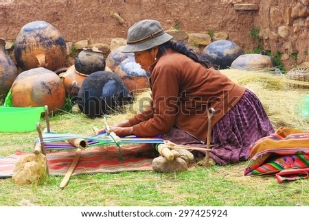 Weaving peruvian cloth - stock photo