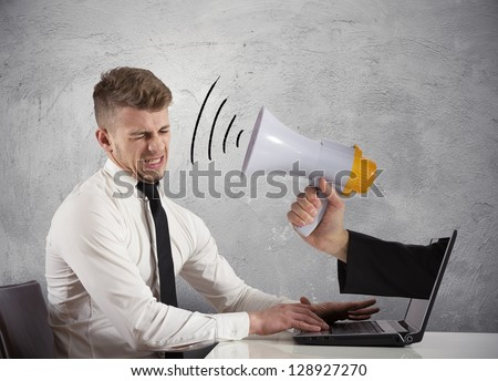 Web advertising and spam concept with businessman and megaphone - stock photo