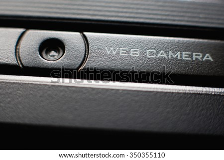 Web camera close up on black laptop monitor. Spy camera (phishing, hack) concept - stock photo