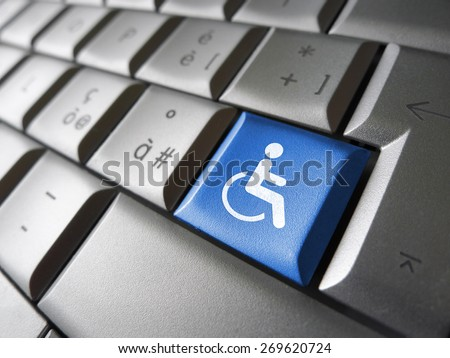 Web content accessibility concept with wheelchair icon and symbol on a blue computer key for blog and online business. - stock photo