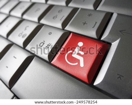 Web content accessibility concept with wheelchair icon and symbol on a red computer key for blog and online business. - stock photo