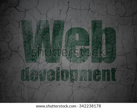 Web design concept: Green Web Development on grunge textured concrete wall background