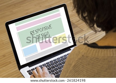 web design concept: responsive design wireframe on a laptop screen - stock photo