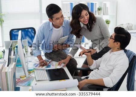 Web designer explaining his ideas to colleagues - stock photo