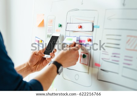 web designer planning application for mobile phone