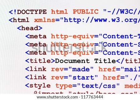Web page HTML source code with document title, metadata description and links monitor screenshot front view - stock photo