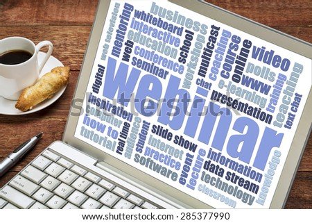 web seminar - webinar word cloud on a laptop screen with a cup of coffee and cookie - stock photo