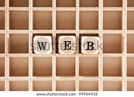 Web word construction with letter blocks / cubes and a shallow depth of field - stock photo