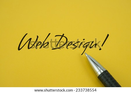 WebDesign! note with pen on yellow background