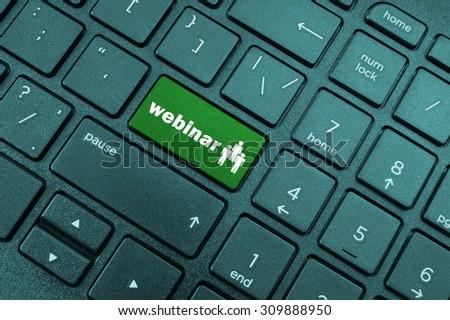 Webinar concept, button webinar on laptop computer keyboard - stock photo