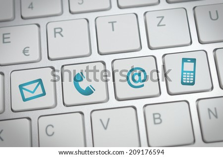 Website and Internet contact us page concept with blue contact icons and symbols - stock photo
