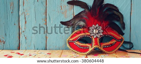 website banner background of colorful Venetian masquerade mask. selective focus. vintage filtered - stock photo