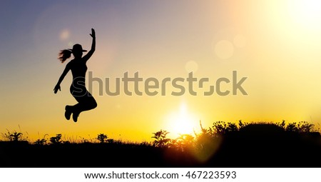 Website banner of a happy female silhouette at sunset