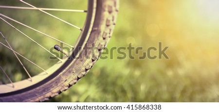 Website banner of a retro bicycle wheel - stock photo