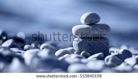 Website banner of Zen balancing pebbles on the beach in blue