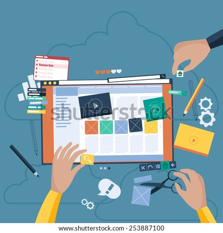Website design concept. Hands that design web site with different blocks. Tablet pc interface. Big Touch pad buttons in flat design style. Raster version - stock photo