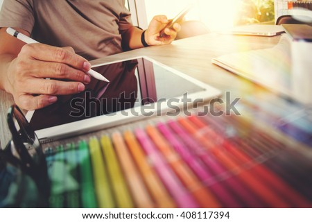 Website designer working digital tablet and computer laptop with smart phone and digital design diagram on wooden desk as concept - stock photo