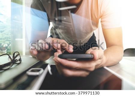 Website designer working digital tablet and smartphone and digital design diagram on wooden desk as concept - stock photo