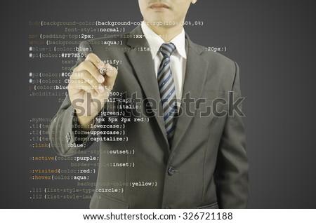 website development - programmer writing CSS code - stock photo