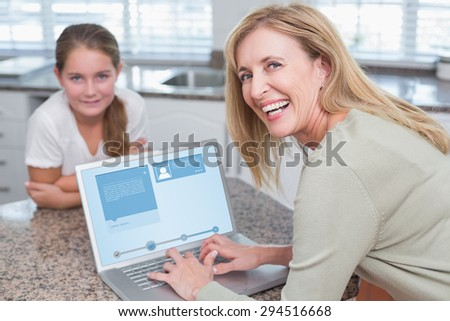 Website interface against happy mother using laptop with her daughter - stock photo