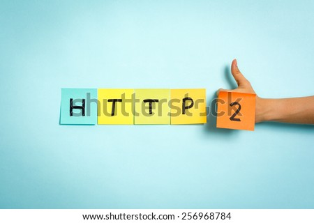 Website protocol HTTP/2 on blue background. Hand making thumb up gesture. - stock photo