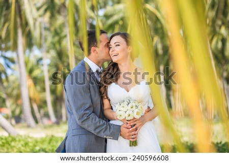 Wedding. A couple in the tropics. Smile
