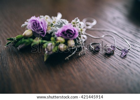 Wedding accessorie, neclace and flowers - stock photo