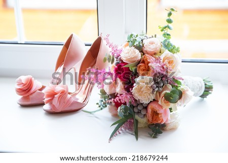 Wedding accessories for the morning of the bride in pink . Wedding bouquet and shoes of the bride. - stock photo
