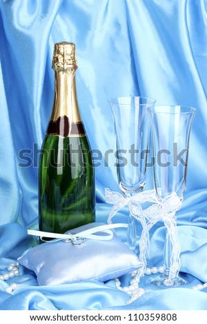 Wedding accessories on blue cloth background