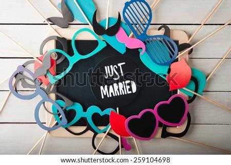 Wedding accessories set on wooden background - stock photo