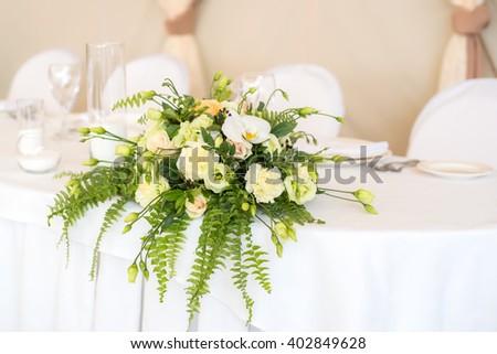 Wedding accessories. Wedding flower arrangement on a banquet table.  - stock photo