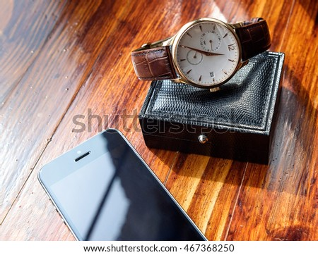 Wedding accessory. Watch, phone and box