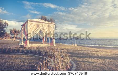 Wedding altar on greek coastline at sunrise - stock photo
